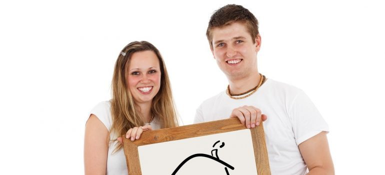 a couple holding a pic