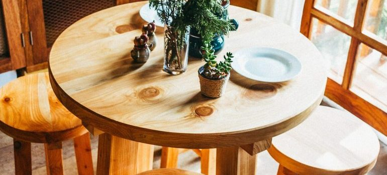 Wooden round table and small wooden chairs in the kitchen