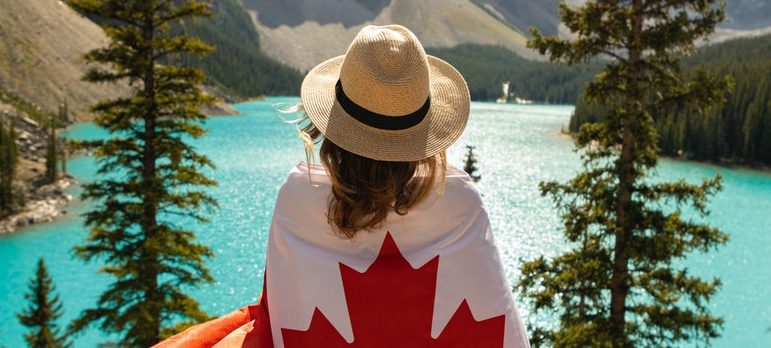 A woman wrapped in the Canadian flag