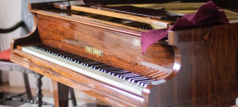 An old piano inside a room
