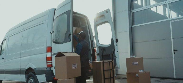 a man loading boxes in the truck
