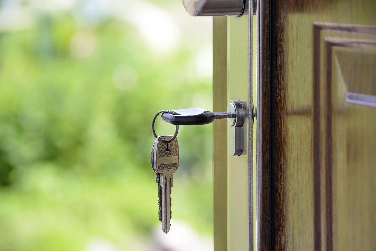 A house key inside a door lock