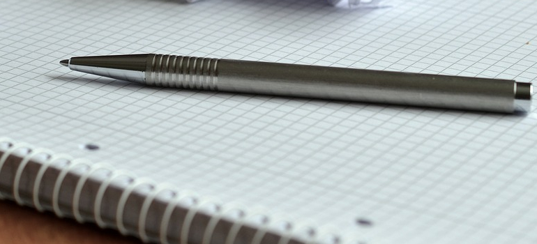 a pen and paper you will use when Planning a garage sale before moving