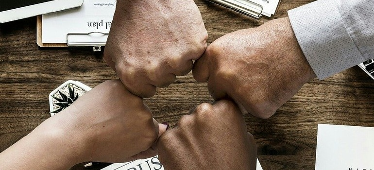 people fist bumping