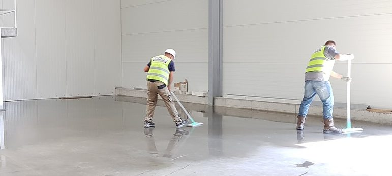 Several people cleaning floors