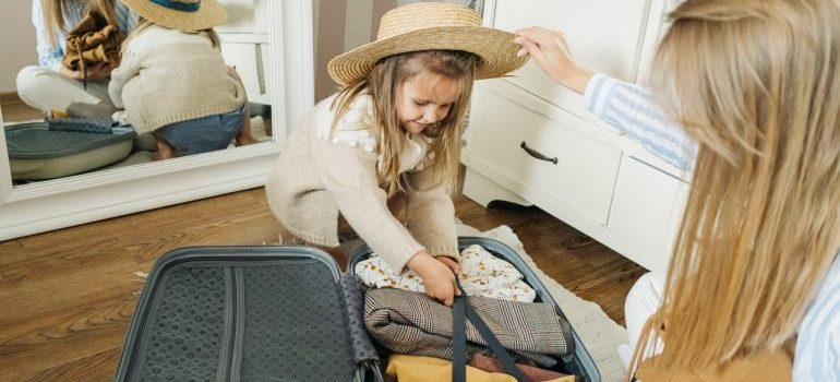 Mother and daughter packing