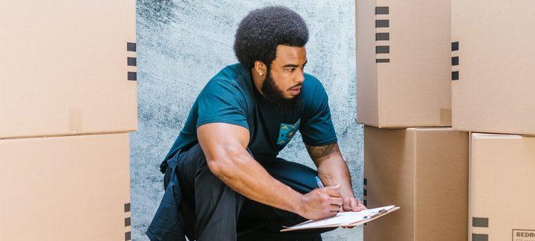 Mover inspecting carton boxes