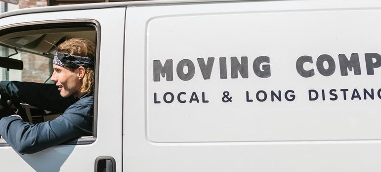 A guy driving a moving truck