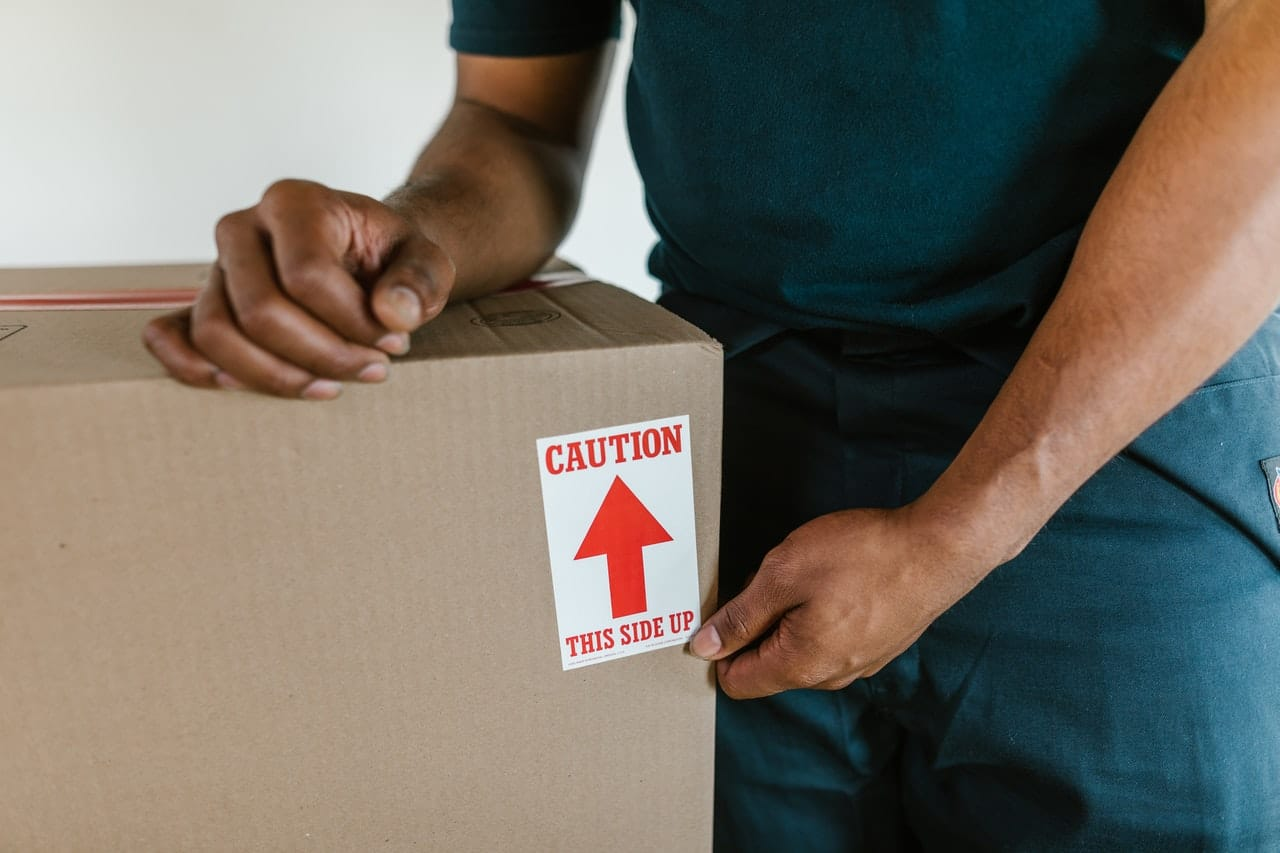 A guy holding a box