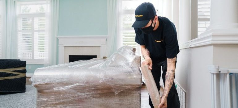 one of long distance movers Canada has wrapping sofa