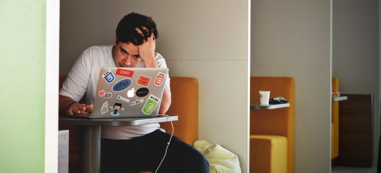 person sitting in front of a laptop