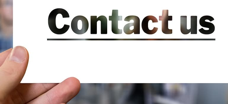 a sign saying contact us