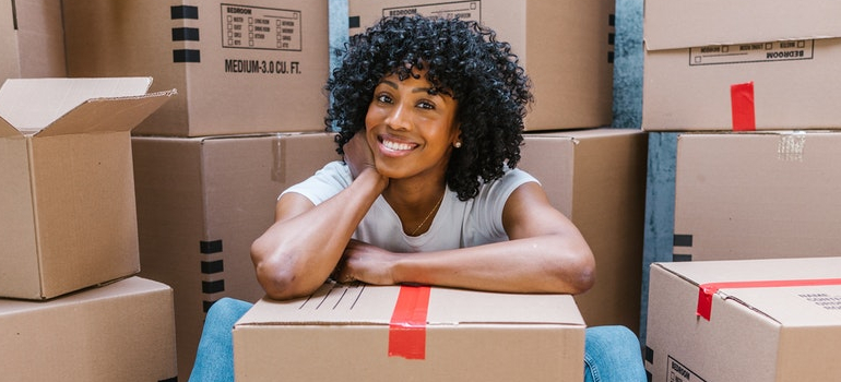 a woman smiling while packing