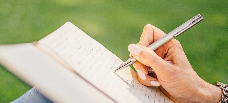 person writing a plan before Moving overseas from Canada