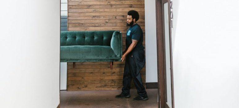 A Cambridge mover helping relocate furniture