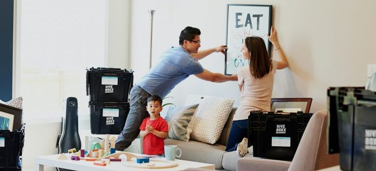 A family decorating their new home