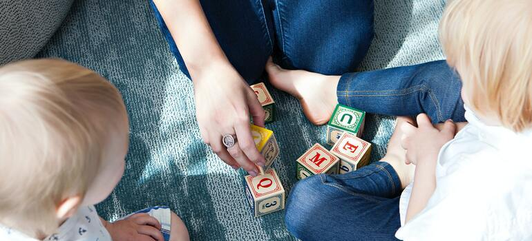 Prepare Your Kids for Moving to a New Home by playing with them