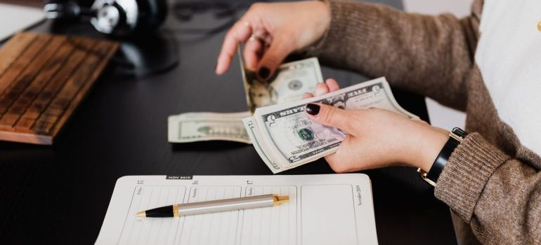 A woman counts money