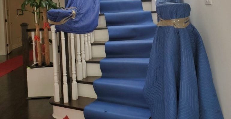 Stairs covered with moving blankets