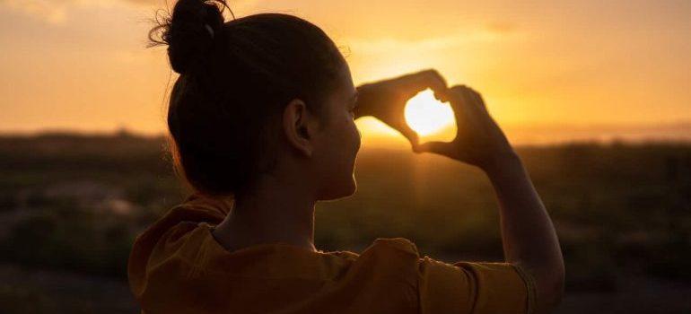 Girl doing heart sign