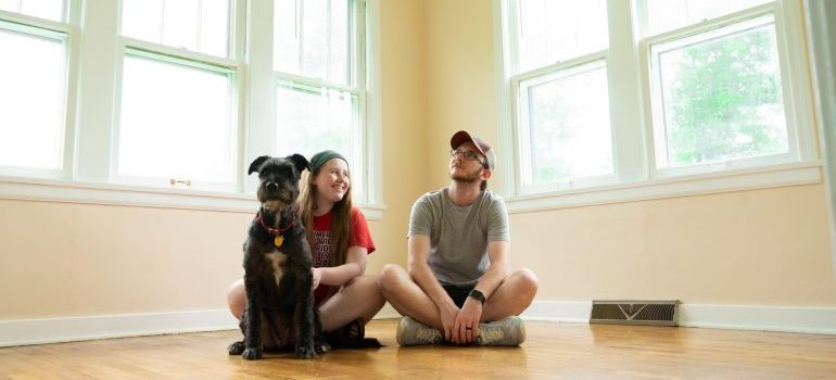 A couple enjoying their new home after comparing moving companies