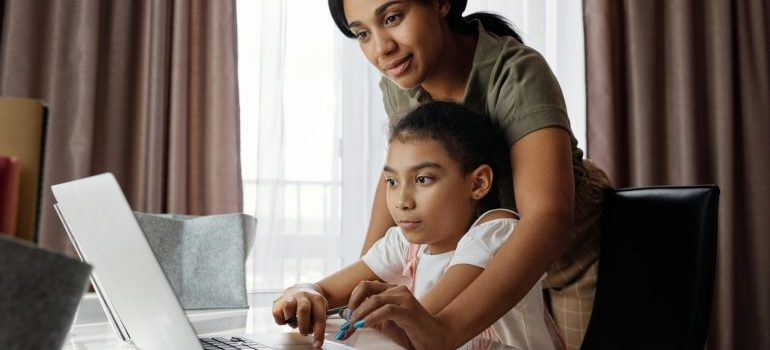 Mom and daughter using a laptop