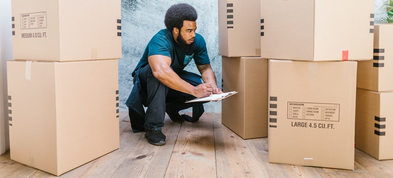 a man checking moving boxes