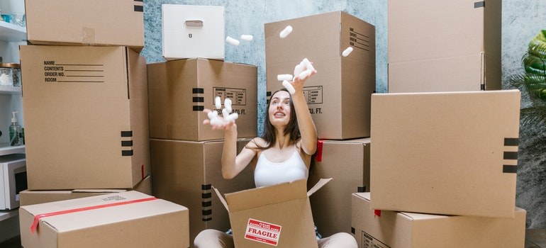 A woman playing with a moving box