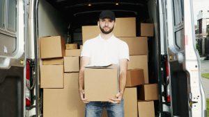 An expert handling boxes