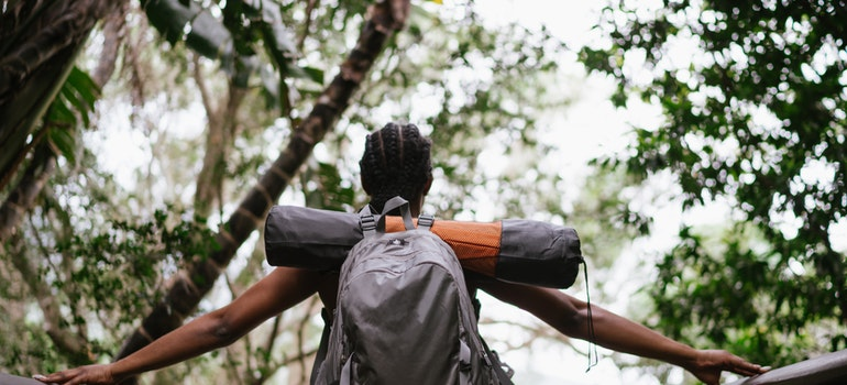 a girl with a backpack going on a hike