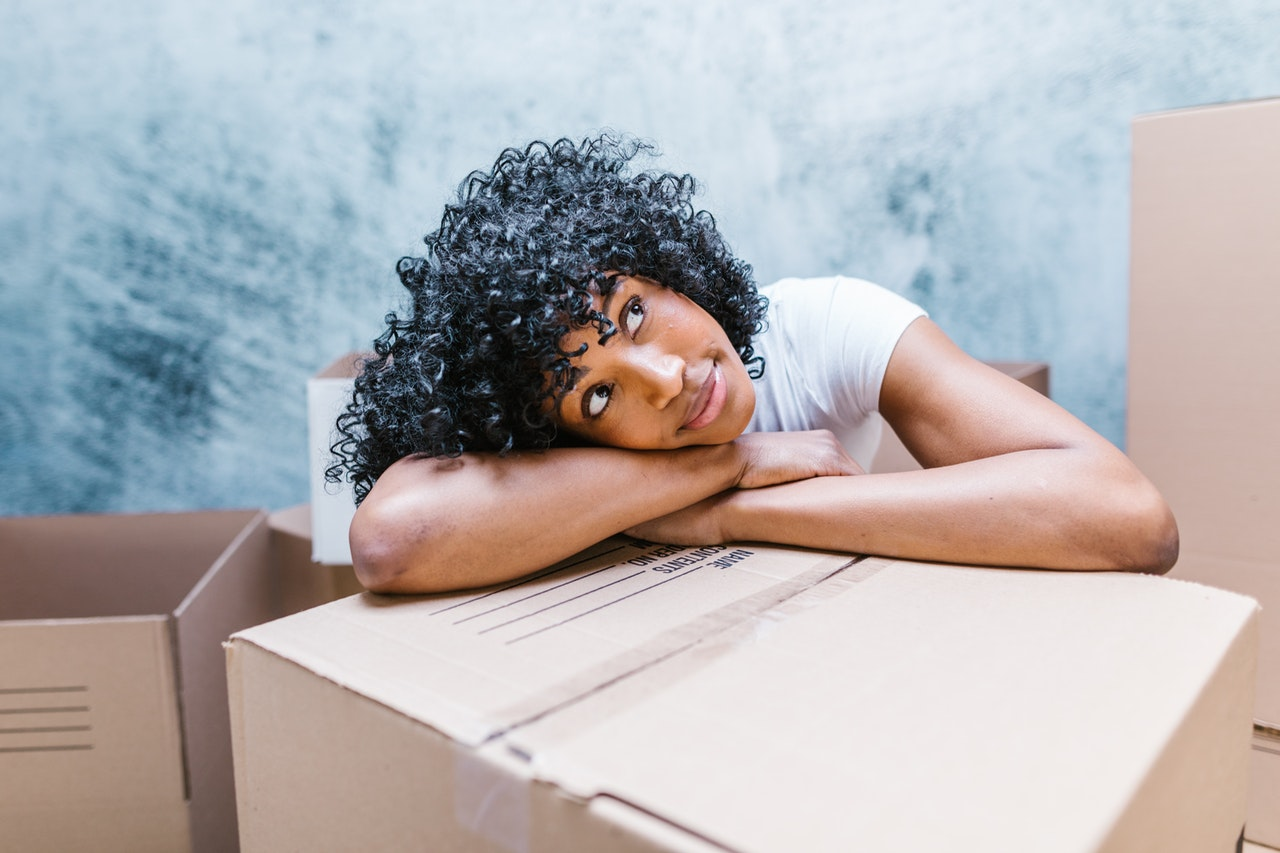 a woman thinking of reasons to move to